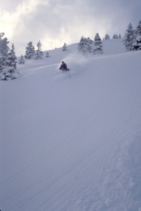 Pat Ellsworth skiing powder in the Wasatch Mtns.